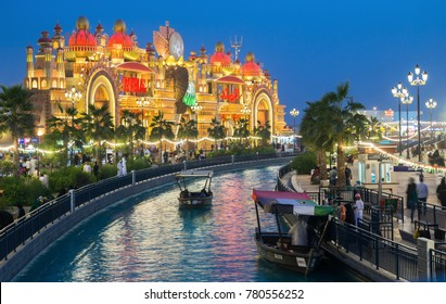 DUBAI, UAE - DECEMBER 4, 2017: Canal with pleasure boats in the park entertainment center Global Village