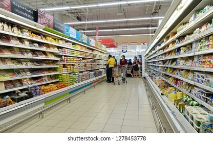 Dubai, UAE - December 8, 2018: Shoppers browse an aisle in a Carrefour supermarket. France's Carrefour is one of the world's largest supermarket chains along with America's Walmart and the UK's Tesco.