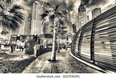 DUBAI, UAE - DECEMBER 9, 2016: Dubai Marina skyline at night as seen from the promenade. The city attracts 30 million tourists annually.