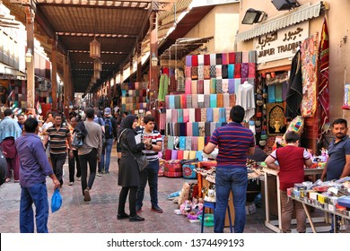 DUBAI, UAE - DECEMBER 9, 2017: People visit the Textile Souk in Bur Dubai, UAE. Dubai is the most populous city in UAE and a major global city.