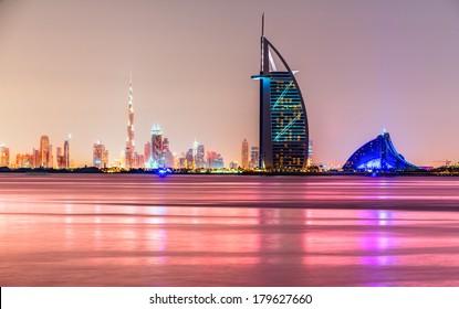 DUBAI, UAE - FEB 08: Skyline view of Dubai showing the iconics Burj al Arab and Burj Khalifa on Feb 08, 2014 in Dubai, UAE. The Burj al Arab is the first seven star hotel in the world.