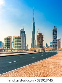 DUBAI, UAE - FEB 08: Skyline view of Dubai showing the Burj Khalifa and skyscrapers of Sheikh Zayed Road on Feb 08, 2014 in Dubai, UAE. The Burj Khalifa, the tallest skyscraper in the world at 829.8m