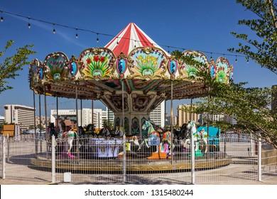 Dubai, UAE - Feb 17, 2019: Carousel for children near Dubai Creek.