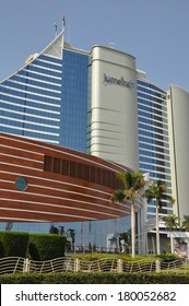 DUBAI, UAE - FEB 17: Jumeirah Beach Hotel in Dubai, UAE, as seen on February 17, 2014. This wave-shaped hotel complements the sail-shaped Burj Al Arab, which is adjacent to it.
