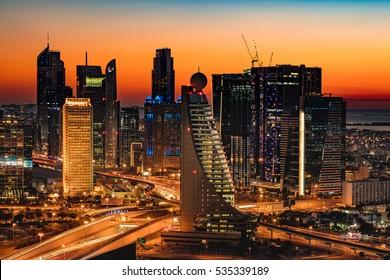 DUBAI, UAE - FEB 18: A beautiful Skyline view of Dubai, UAE as seen from Dubai Frame at sunset showing World Trade Centre, H Hotel, Fairmont, Conrad and Etisalat Tower on Feb 18, 2016 in Dubai, UAE