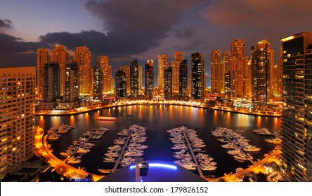 DUBAI, UAE - FEB 19: A view of Dubai Marina at Dusk showing numerous skyscrapers of JLT on Feb 19, 2014 in Dubai, UAE. Dubai Marina is an artificial 3 km canal carved along the Persian Gulf shoreline