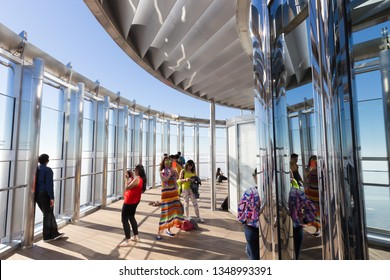 Dubai, UAE - Feb 21, 2016: Tourists taking photos of Dubai from the top the observation deck of the highest building in the world,Burj Khalifa in Dubai, UAE on 21nd of February, 2016.