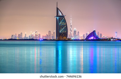DUBAI, UAE - FEBRUARY 08, 2014: Skyline view of Dubai showing the iconics Burj al Arab and Burj Khalifa in Dubai, United Arab Emirates. The Burj al Arab is the first seven star hotel in the world.
