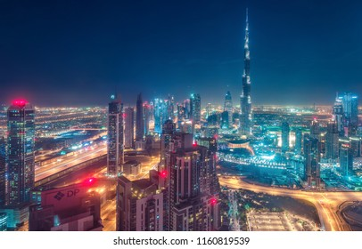DUBAI, UAE - FEBRUARY 10, 2017: Elevated view on downtown Dubai, UAE, at night with Burj Khalifa and skyscrapers of the business bay.