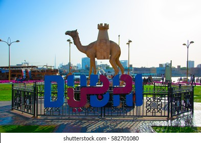 DUBAI, UAE - FEBRUARY 10, 2017: The logo of Dubai against a background of a camel sculpture with a tower instead of a hump.