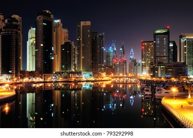 Dubai, UAE - February 11, 2012: Beautiful Dubai Marina night view with skyscrapers and reflections in the water.