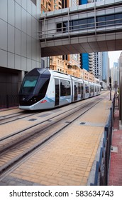 DUBAI, UAE - FEBRUARY 12, 2017: A new tram Alstom Citadis 402 arrives on the station number 7 - Mina Seyahi, Dubai