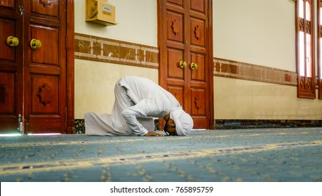 Dubai, UAE, February 13, 2016: Muslim man demonstrates Salah or muslim prayer during public lecture on Islam at Jumeirah Mosque in Dubai