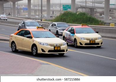 DUBAI, UAE - FEBRUARY 13, 2017: Dubai public taxi is on the way on Sheikh Zayed Road
