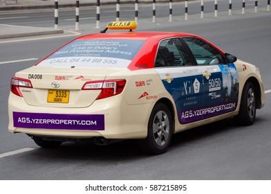 DUBAI, UAE - FEBRUARY 13, 2017: Dubai public taxi parked on Sheikh Zayed Road