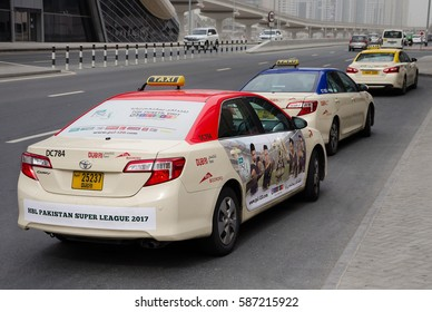 DUBAI, UAE - FEBRUARY 13, 2017: Dubai public taxi parked near Jumeirah Lakes Towers metro station