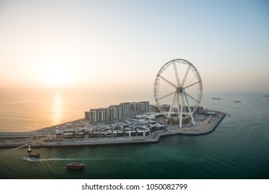DUBAI, UAE - February 16, 2018: Aerial view of the Dubai Eye and the huge Ferris Wheel that should soon become main attraction on Bluewaters Island in Dubai, UAE
