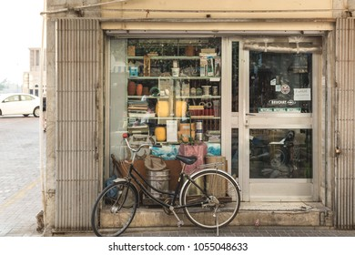 Dubai, UAE February 17, 2018: old classic bicycle parked at the window of a small shop