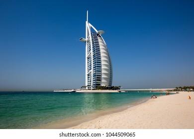 Dubai, UAE - FEBRUARY 18, 2018: Burj Al Arab iconic Dubai hotel. 7 star luxury hotel. Symbol of Dubai. Beach resort. Famous sail shape hotel. The most luxurious hotel in the world.