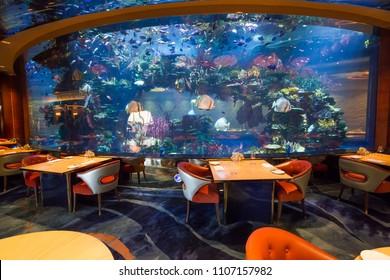 Dubai, UAE - FEBRUARY 18, 2018: Al Mahara luxury Burj Al Arab restaurant. Interior of Burj Al Arab famous Dubai hotel. 7 star luxury hotel. Iconic the most luxurious restaurant and hotel in the world.