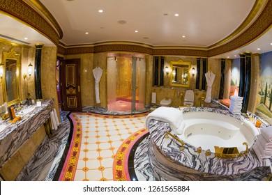 Dubai, UAE - FEBRUARY 18, 2018: Burj Al Arab royal suite. Bathroom. Interior of Burj Al Arab famous Dubai hotel. 7 star luxury hotel. Iconic the most luxurious hotel in the world. Luxury jacuzzi.