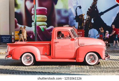 Dubai, UAE February 19, 2018: Old blue Chevrolet Advance Design 3100 rides on the road. Color of the year 2019 Living Coral. Livingcoral