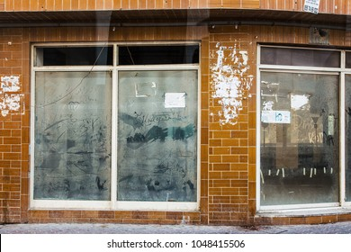 Dubai, UAE February 19, 2018:The dusty painted window of an abandoned shop window