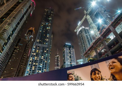 DUBAI, UAE - FEBRUARY 20, 2017: Skyscrapper construction at night