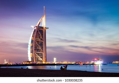 DUBAI, UAE - FEBRUARY 2018 :The world's first seven stars luxury hotel Burj Al Arab at night seen from Jumeirah public beach in Dubai, United Arab Emirates