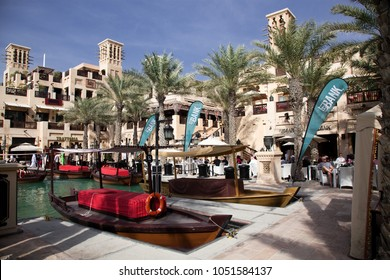 DUBAI, UAE - FEBRUARY 2018: Traditional abra boats in Souk Madinat Jumeirah. Madinat Jumeirah encompasses two hotels and clusters of 29 traditional Arabic houses.