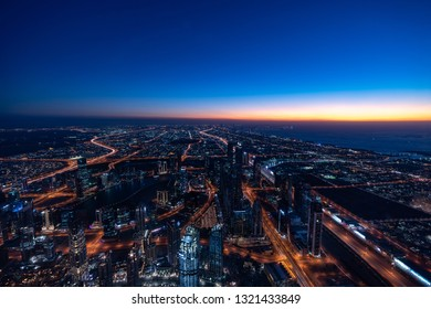 Dubai / UAE - February 2019: Dubai cityscape at Magic Hour. Dubai is the largest and most populous city in the United Arab Emirates.