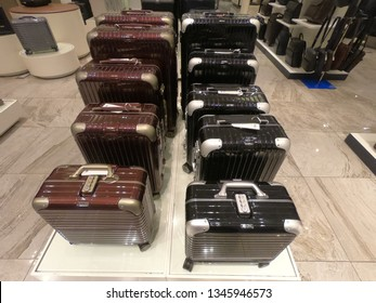 Dubai UAE - February 2019 - Display of colorful metal suitcases in Rimowa store. Rimowa is a German company known for its sturdy aluminum and polycarbonate sturdy carry-on luggage.