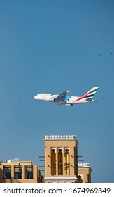Dubai, UAE. February, 2020. Airbus 380-800 of the Emirates Airlines flys over Dubai with the logo of the Dubai EXPO 2020 which opens on October 20th.