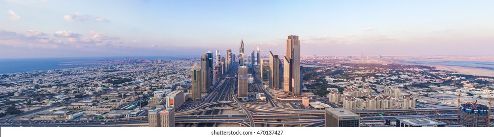 DUBAI, UAE - FEBRUARY 21, 2014. Panorama aerial view on Dubai main street - Sheikh Zayed Road and skyscrapers in evening on sunset