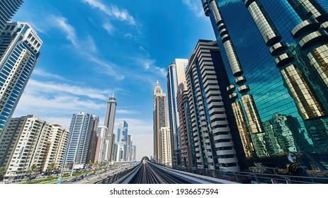 DUBAI, UAE - FEBRUARY 21 2018: Dubai cityscapes - buldings, skyscrapers, roads, sun and reflections.