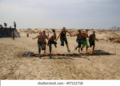 DUBAI, UAE - FEBRUARY 26, 2016: Competitors participate in the 2016 obstacle racing challenge in Dubai, United Arab Emirates, on February 26, 2016.