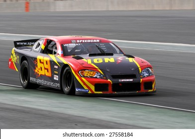 DUBAI, UAE - FEBRUARY 27: Speedcar Series driver Johnny Herbert in action at Dubai Autodrome. The Speedcar Series Championship is a stock car racing with several ex F1 drivers held in Dubai, UAE on Feb. 27, 2009.