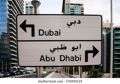 DUBAI, UAE - FEBRUARY 4, 2017:  A direction sign: for Dubai turn to the left, for Abu Dhabi turn to the right, Jumeirah Lakes Towers