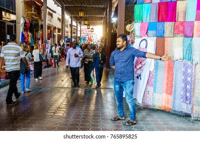 Dubai, UAE, February 5, 2016: Bustling shopping street of Dubai Textile Souk in Bur Dubai