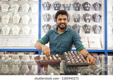 DUBAI, UAE - FEBRUARY 7, 2015: Saleman with a tray of diamond rings in a shop at the Gold Souk in Deira in Dubai, Unted Arab Emirates