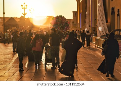 DUBAI, UAE - JAN 18, 2019: People strolling thru the pavillions of the world at the Global Village, Dubai. Late afternoon before sunset.