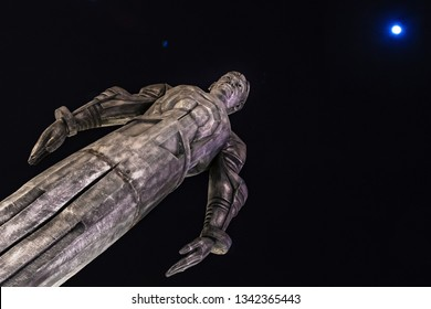 DUBAI, UAE - JAN 18, 2019: Yuri Gagarin mockup statue at the Russian pavilion at the global village in Dubai. Moon and flares in blue.