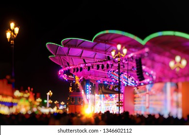 DUBAI, UAE - JAN 18, 2019: The colorful main stage at the Global Village in the Dubai outskirts. Thousands of spectators during the evening.