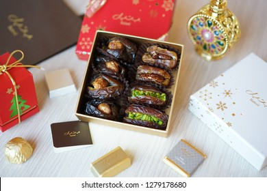 Dubai, UAE - Jan 2, 2018 : Premium asserted dates and chocolates in a festive boxes to celebrate gift giving season of Christmas and New Year, produced by Bateel International, HQ in Saudi Arabia.
