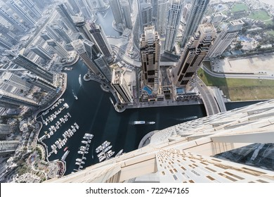 DUBAI, UAE - JAN 20, 2017: (top view) Wall of Cayan Tower in Dubai Marina area, Cayan is tallest building in world, which is twisted by 90 degrees