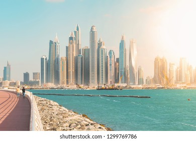 DUBAI, UAE - JAN 20, 2019:  Walkway at the palm with view over the Dubai marina district during a bright sunny day in vivid colors.