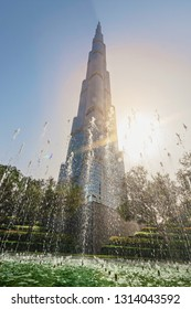DUBAI, UAE - JAN 23, 2019: Fountain at a park below the building Burj Khalifa during a sunny day.