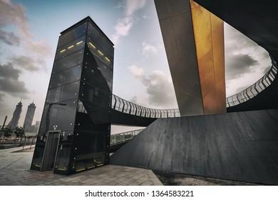 DUBAI, UAE - JAN 23, 2019: Elevator tower in black at the Tolerance bridge in Dubai City during daytime.