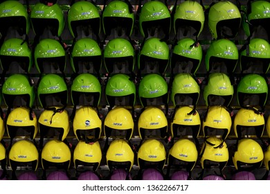 DUBAI, UAE - JAN 24, 2019: Many colorful helmets for hire at Ski Dubai inside the Mall of Emirates. Green, yellow and purple helmets in a abstract setting.