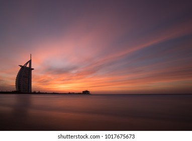 Dubai, UAE - Jan 29, 2018: Dubai beach during a stunning colorful sunset as viewed from the public beach.
